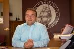 Argo Community High School Principal, Dr. Covino, at his desk.