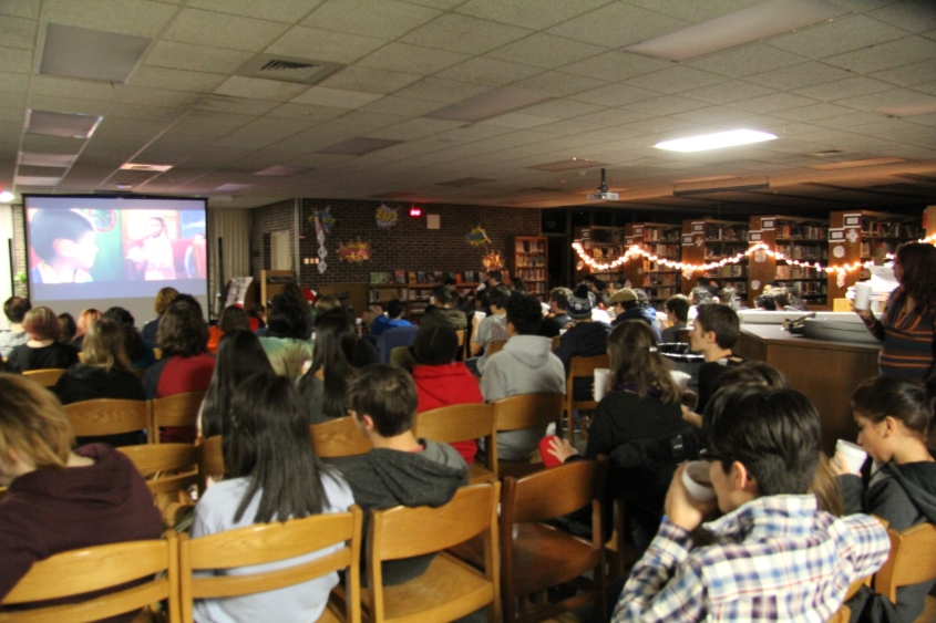 The audience enjoys some hot cocoa at the Polar Express Night hosted by the Argo Ambassadors.